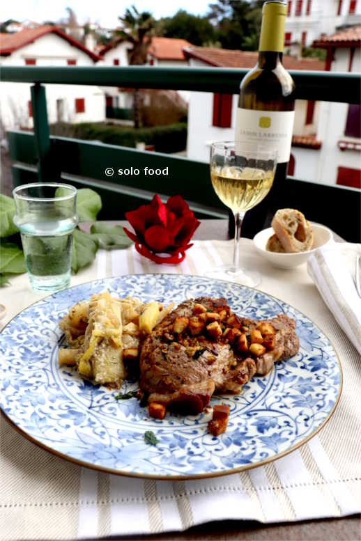 Pork chop with rosemary and garlicky-lemon croutons